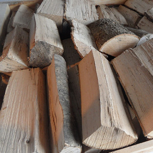 A photo of the ash hardwood logs we supply in stacked crates. Click the image to view all of our logs for sale.
